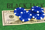 Five blue chips lie on a bill fifty dollars - 148782854