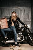 Erotic girl biker with rusty metallic gas can