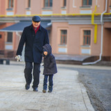 Grandpa and his grandson on a city walk in Kyiv