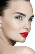 Fashion Makeup. Young Woman With Perfect Makeup And Red Lips