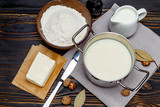 bechamel sauce in a pan and ingredients - 148893457