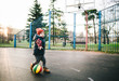 The kid plays basketball