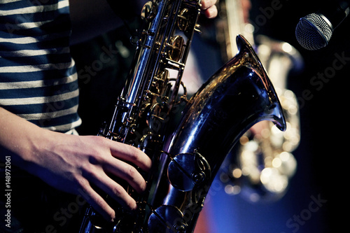 Sax player on the stage Poster