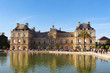 View on Luxembourg palace and garden with reflection and fountain, front view, paris city, france