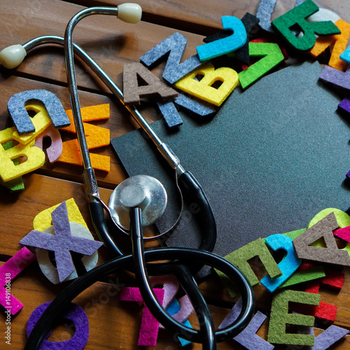 Alphabets with stethoscope and black board.copy space area. Poster