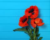 Red poppy on wood
