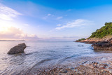 beautiful seashore with wooden walkway bridge and mountain landscape in morning sunrise