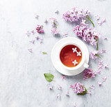 Cup of tea with lilac flowers on marble background - 149327418