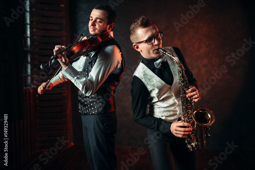 Saxophonist and violinst playing classical melody Poster