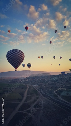 Aerial view of hot air balloons fly over field in Cappadocia, Turkey