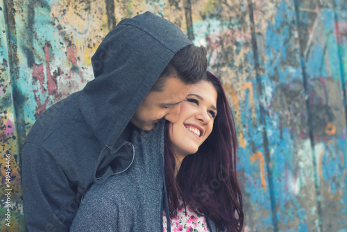Young teenage couple having fun outdoor. Poster