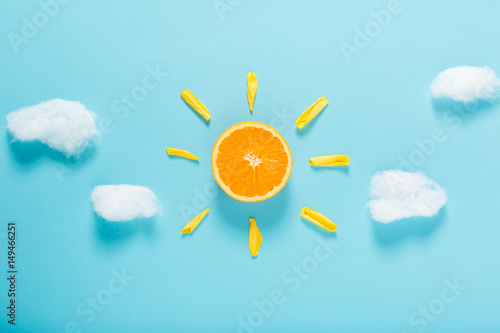 Orange slice as the sun concept