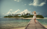A girl in a white dress and hat is standing on a bridge. Maldives. Island. Tropics. - 149553823
