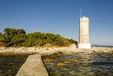 lighthouse at sunset, horizontal view of a lighthouse tower at sunset, dalmatia, croatia
