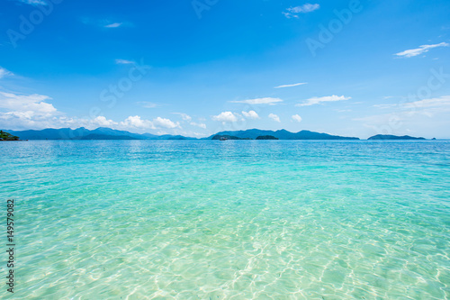 Obraz na Plexi beach landscape background for summer travel with sun,coconut tree on white sand beach with beautiful blue sea and sky, abstract background for summer vacation concept.