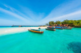 Fototapety colorful exotic seascape with boats near Zanzibar shore in Africa