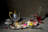 vintage style food still life with noble petit four candies and old dishes