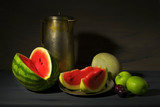 vintage style food still life with watermelons and other fruit