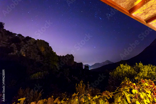 Night View from wooden outdoor terrace of suburban holiday cottage