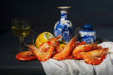 vintage style food still life with king prawns and a glass of white wine