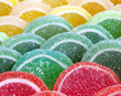 Colorful sugary marmalade like lemon and orange slices with handmade lollipop candies. - 149673456