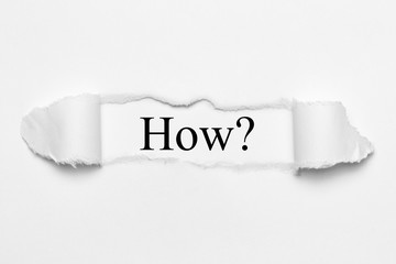 How? on white torn paper