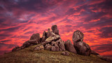 Sunset over rocks formations in Dobrogea, Tulcea county, Romania. Naturally formed piles of large rocks in Macin Mountain, the olders alps in Europe.