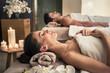 Leinwanddruck Bild - Man and woman lying down on massage beds at Asian wellness center