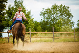 Cowgirl doing horse riding on countryside meadow - 149767050