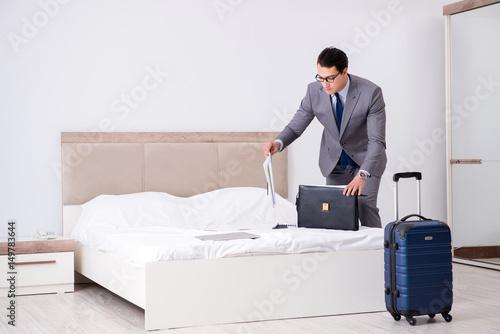 Plagát Businessman working in hotel room