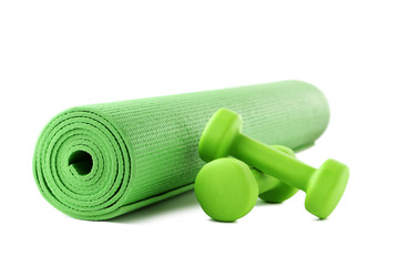 Green dumbbells with fitness mat isolated on white background © 5second