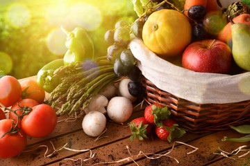Fruits and vegetables on table and crop landscape background elevated