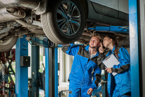 Man and woman in auto mechanics