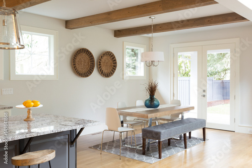 Elegant Dining Room in New Luxury Home with French Doors Leading to Patio and La Poster