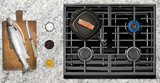 Cooking salmon fish on gas stove - 149925809
