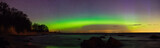 Starry sky and aurora borealis over sea