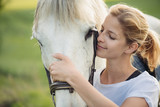 Blonde woman with white horse - 149948837