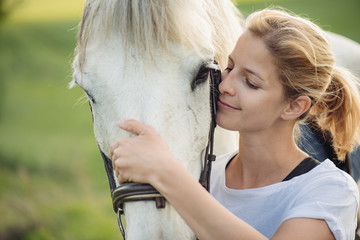 Blonde woman with white horse
