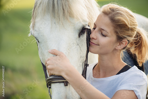 Blonde woman with white horse Poster