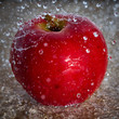 Apple in the spray of water - 149991648