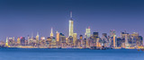 New York City Manhattan downtown skyline at dusk with skyscrapers illuminated over Hudson River panorama. Horizontal composition. - 149998220