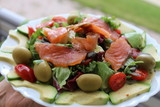 Delicious healthy salad with salmon, olives, avocado and cherry tomatoes - 150017224