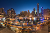 Dubai Marina Towers in a beautiful blue sunset with reflection on dubai marina bay