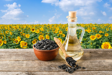 sunflower oil and seeds on table