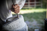 Chiseling a Stone by Hand