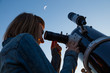 Girl looking at the Moon through a telescope. My astronomy work. - 150088639