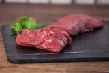 Beef steak on black slate plate