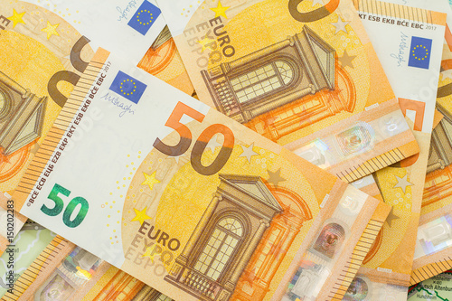 Poster many 50 euro banknotes background