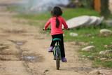 Poor girl on a bike