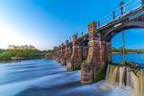River weaver sluice gates Northwich Cheshire UK at sunset